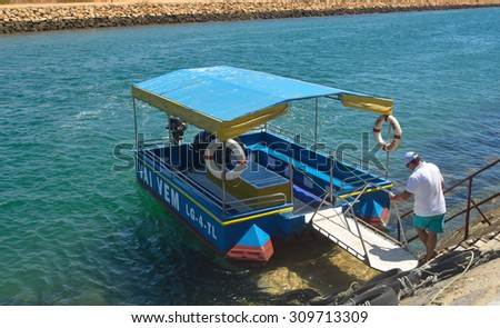 LAGOS, ALGRAVE, PORTUGAL - AUGUST 15, 2015: The Little Ferry that takes people across the estuary at Lagos Portugal.