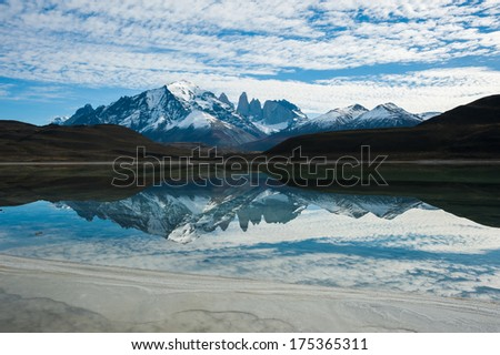 Laguna Amarga with the reflection of Cordillera del Paine, Torres del Paine National Park, Chile  - stock photo