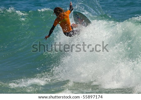 LAGUNA BEACH, CA-June 19:  Surfer skims in the 34th Annual Victoria Skimboards World Championship in Laguna Beach, CA. Competition was held on June 19 & 20, 2010 and sponsored by SkimChicks. - stock photo