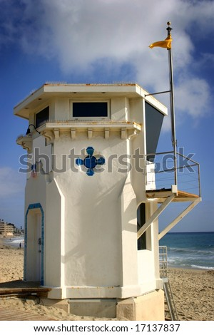 Laguna Beach lifeguard tower with the ocean in the background. - stock photo