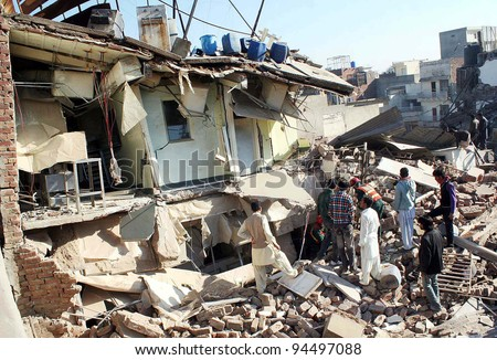 LAHORE, PAKISTAN - FEB 06: Rescue workers busy in rescue operation at the site of building collapse incident on February 06, 2012 in Lahore.