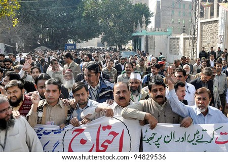 LAHORE, PAKISTAN - FEB 10: Sui Northern Gas Company employees chant slogans in favor of their demands during protest demonstration at SNGC MD office at Kashmir road on February 10, 2012 in Lahore, Pakistan. - stock photo
