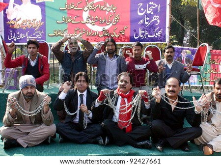 LAHORE, PAKISTAN, JAN 09: Activists of Jevey Pakistan Party are protesting in favor of their demands during demonstration at high court building in Lahore on Monday, January 09, 2012. - stock photo