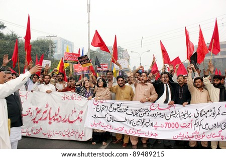 LAHORE, PAKISTAN - NOV 24: Supporters of Trade Union Federation (APTUF) shout slogans in favor of their demands during protest demonstration on Thursday, November 24, 2011in Lahore, Pakistan. - stock photo