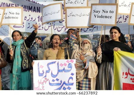 LAHORE, PAKISTAN - NOV 29: Supporters of Women Workers Helpline shout slogans against torture on women during a protest demonstration on November 29, 2010 in Lahore, Pakistan.