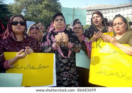 LAHORE, PAKISTAN - OCT 15: Opposition members of Punjab Assembly offer Dua during their protest demonstration in favor of their demands at Shahrah-e-Quaid-e-Azam in Lahore on October 15, 2011. - stock photo