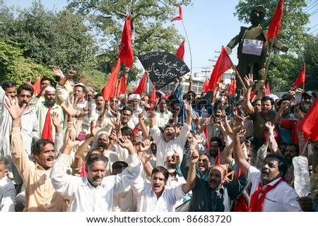 LAHORE, PAKISTAN - OCT 15: Supporters of Railways Workers Union shout slogans in favor of their demands during a protest demonstration at Lahore press club on October 15, 2011 in Lahore. - stock photo