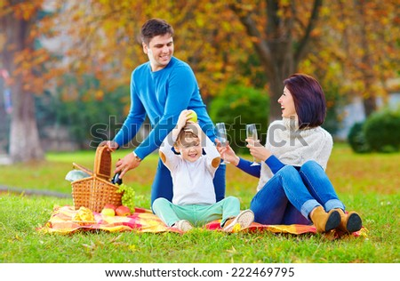 laid-back moment of family on autumn picnic - stock photo