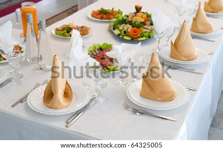 laid banquet restaurant table with golden napkins