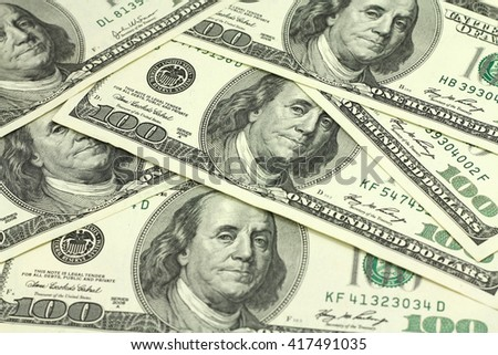 laid out in the bill hundred American dollars abstract background