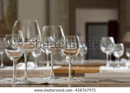 Laid table in an elegant restaurant with some wine glasses.