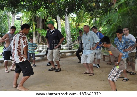 LAIE, HAWAII - DEC 26: Cultural activities at the Polynesian Cultural Center on Dec 26, 2012 in Laie, Oahu, Hawaii. The center is owned by The Church of Jesus Christ of Latter-day Saints (LDS Church). - stock photo