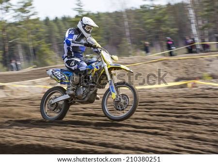LAITILA, FINLAND - APRIL 20: A motocrosser drives in a track. Image taken in West Cross Weekend championships in Laitila, Finland in April 20th 2014.