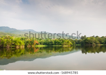 Lake among the mountain and reflection on the water surafce in Chaingmai, Thailand