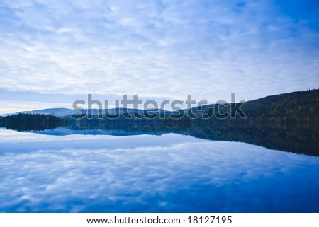 lake and forest at sunrise in Finland - stock photo