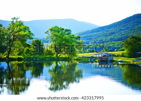 lake and green grass, summer landscape, nature in Crimea