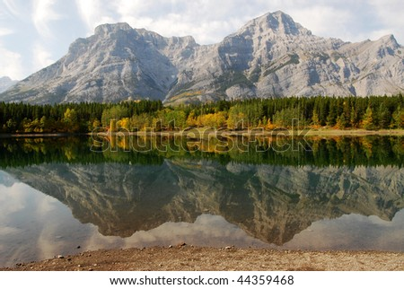Lake and mountain reflections in wedge pond in the morning moment, kananaskis country, alberta, canada