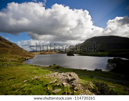 Lake and mountains near Cadir Idris - stock photo