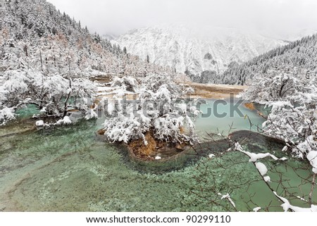 lake and snow mountain in huanglong, china - stock photo