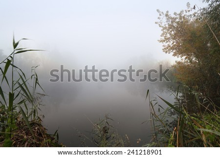 Lake and the foggy morning - stock photo