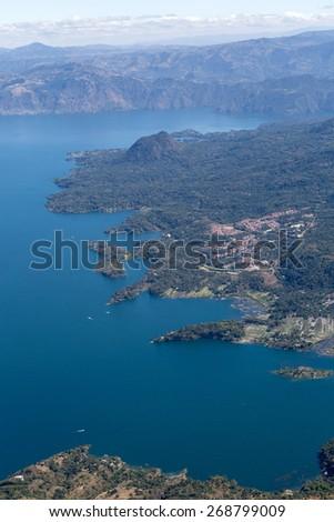 lake atitlan seen from the top of san pedro volcano in guatemala - stock photo