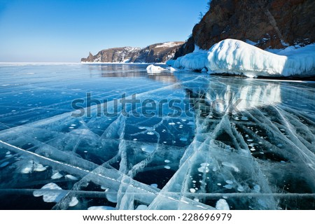 Lake Baikal in winter. Beautiful drawings on ice from cracks and bubbles of deep gas  - stock photo