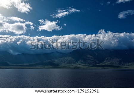 Lake Baikal is the deepest lake in the World. Olkhon Island is the largest island of Lake Baikal. Baikal Mountains - stock photo