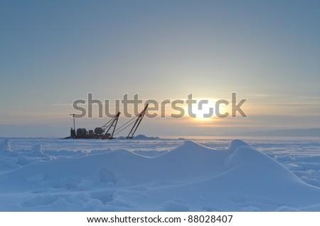 Lake Baikal, Sun in the show desert - stock photo
