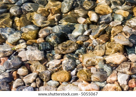 lake Baikal unadulterated water - depth of water is about half meter (lake Baikal - first-rate reservoir of unadulterated sweet water, it contains about 1/4 of all world's reserve) - stock photo