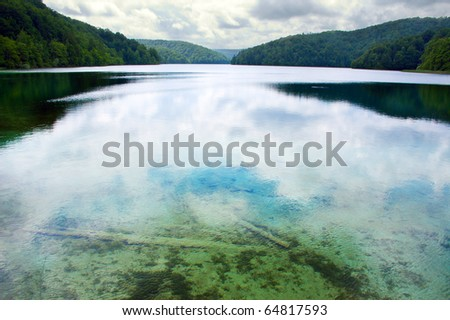 lake between deep forest - stock photo