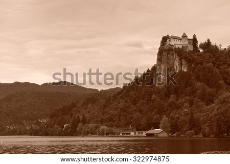 Lake Bled with the rock top castle. Slovenia. Sepia toned image. - stock photo