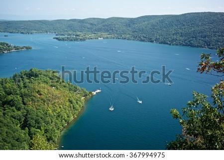 Lake, Boat, Mountain in Adirondacks - stock photo