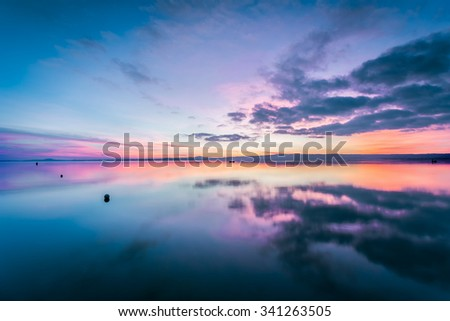 Lake Bolsena at sunset. A wonderful place surrounded by the countryside of Lazio. It is the largest volcanic lake in Europe. - stock photo