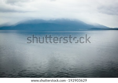 Lake Brunner with low cloud brushing the hills. South Island New Zealand. - stock photo