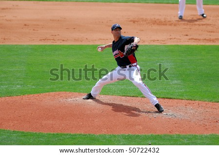 LAKE BUENA VISTA, FL - MARCH 24: Atlanta Braves pitcher Tim Hudson delivers a pitch during the spring training game on March 24, 2010 in Lake Buena Vista, FL.