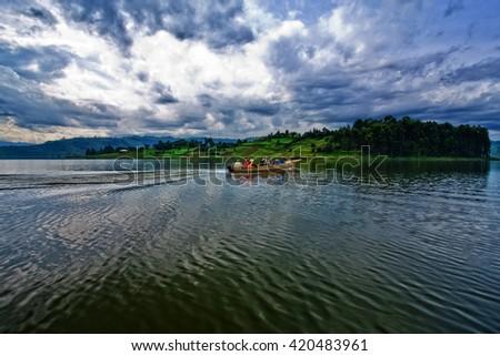 Lake Bunyonyi in Uganda, Africa, at the borders of Uganda, Congo Democratic Republic and Rwanda, not far from the Bwindi National Park, home of the last mountain gorillas - stock photo