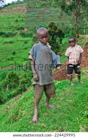 LAKE BUNYONYI, UGANDA - OCTOBER 21: unidentified Batwa pigmy boys on October 21, 2012 at Lake Bunyonyi, Uganda. Pigmy people are ancient dwellers in the forests, they were known as 'The Keepers of the Forest'