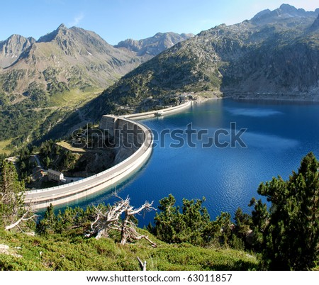 Lake Cap-de-Long  in French Hautes-Pyrenees, At an elevation of 2161 m its 130 deap. Its created by grate dam used for hydroelectric energy station. - stock photo