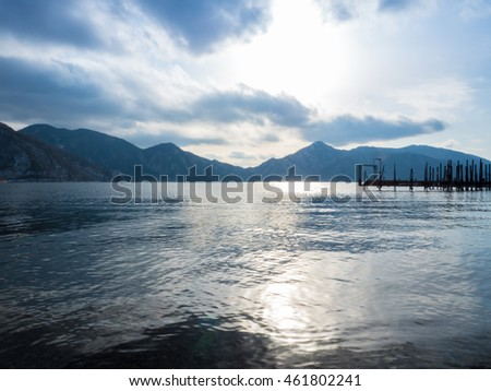 Lake Chuzenji, backlit of wood bridge and mountain, sunlight and cloud, Nikko, Japan