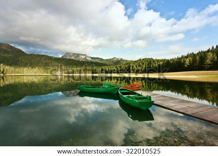 lake,clouds,reflections and boats