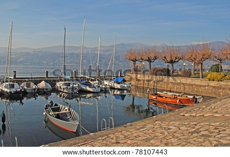 Lake Como, Italy. Scenic landscape with boats and waterfront in early spring.