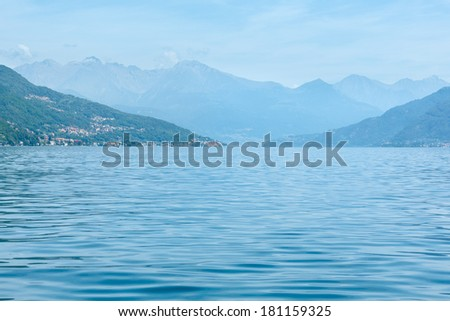 Lake Como (Italy) summer coast hazy view from ship board.
