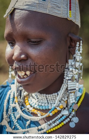 LAKE EMPAKAI, TANZANIA-AUG 15:  Masai woman near lake Empakai, Tanzania, on Aug 15, 2010. Maasai (Masai) are a Nilotic ethnic group of semi-nomadic people located in Kenya and northern Tanzania - stock photo