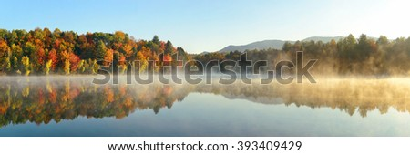Lake fog panorama with Autumn foliage and mountains with reflection in New England Stowe - stock photo