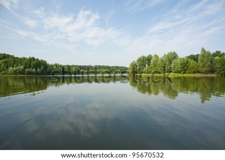 Lake forest clouds - stock photo
