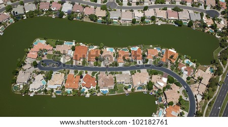 Lake front homes in a desert community - stock photo
