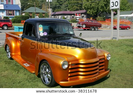 LAKE GEORGE, NY - SEPT 12: An early 50's Chevy Pickup being shown off at the 21st Annual Adirondack Nationals on September 12, 2009 in Lake George, NY - stock photo