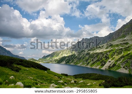 Lake high in mountains in summer