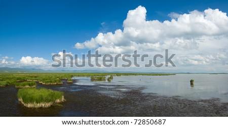 lake(hua lake),sky,cloud and wetland at gansu province qinghai-tibet plateau china - stock photo