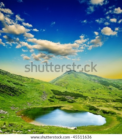 lake in a mountain valley at the evening - stock photo